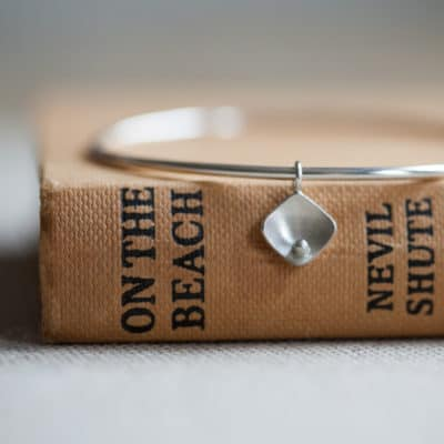 recycled silver bangle with pearl charm