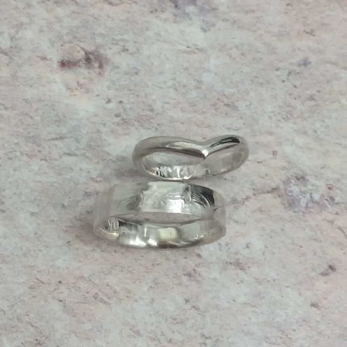 Amy and Same make wedding rings